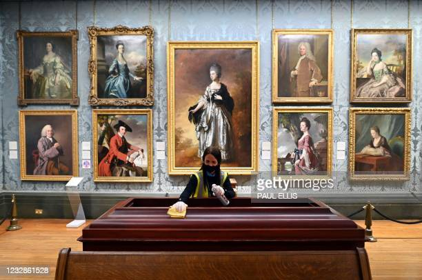 Housekeeping staff member dusts near Thomas Gainsborough's 'Isabella, Viscountess Molyneaux' in the Walker Art Gallery in Liverpool, north west...