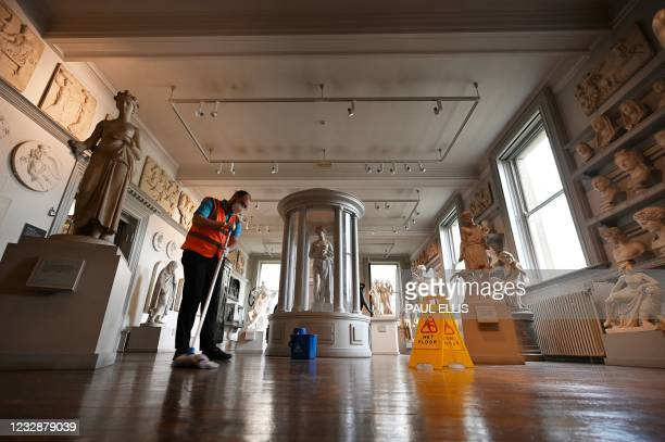 Housekeeping staff member mops the floor in the Sculpture Room of the Walker Art Gallery in Liverpool, north west England on May 13 as National...