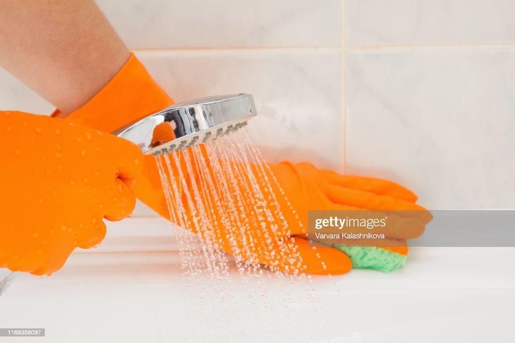 Housemaid cleaning a bathroom, closeup shot : Stock Photo