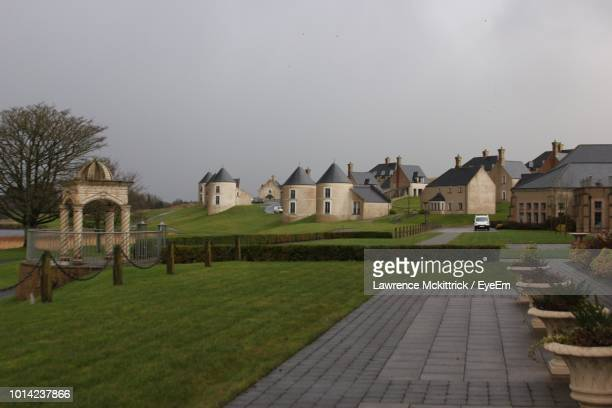 houses against clear sky - county fermanagh stock photos and pictures