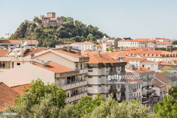 houses against clear sky - leiria district stock photos and pictures