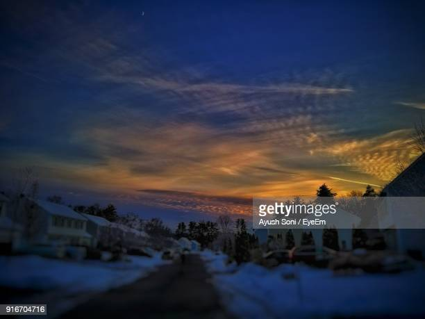 houses against sky during winter - lowell massachusetts stock pictures, royalty-free photos & images
