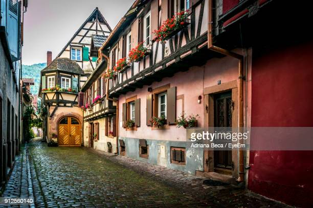 houses against sky - colmar stock photos and pictures