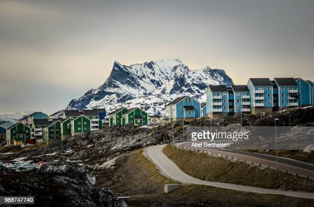houses against snow covered mountain, nuuk, greenland - capital cities stock pictures, royalty-free photos & images