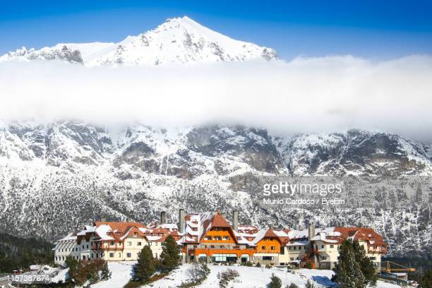 houses against snowcapped mountains during winter - bariloche stock pictures, royalty-free photos & images