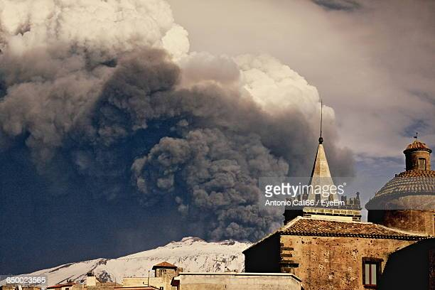Houses Against Snowcapped Mt Etna Emitting Smoke
