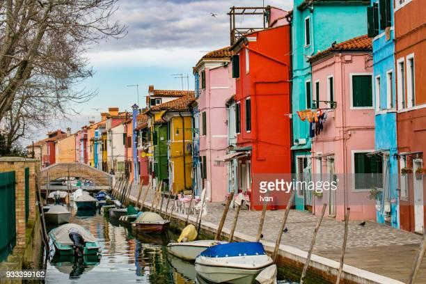 houses along a street, burano, venetian lagoon, venice, veneto, italy - murano stock pictures, royalty-free photos & images