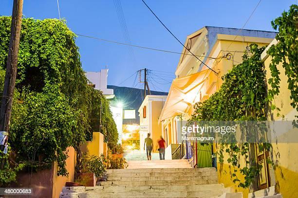 houses along kali strata, the stairway to chorio - symi stock photos and pictures