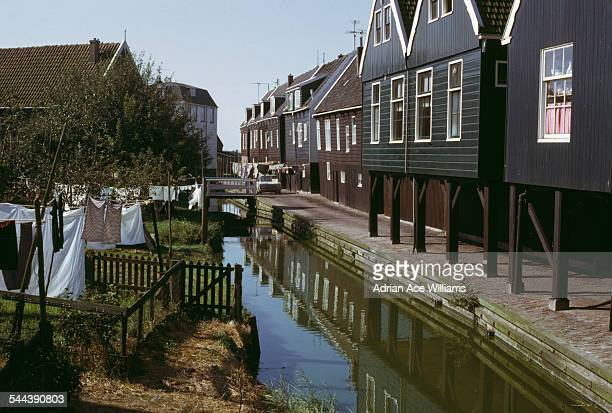 Houses along the canal in Volendam Netherlands circa 1965