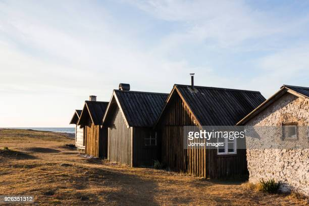 Houses and barns near sea coast