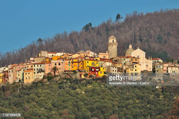 houses and buildings against clear sky - antonella di martino foto e immagini stock
