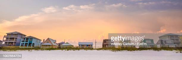 houses and buildings against sky during sunset - gulf shores alabama stock pictures, royalty-free photos & images