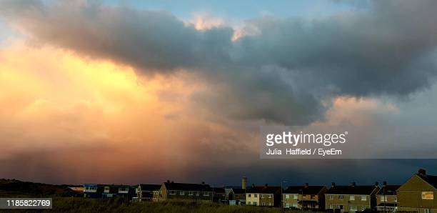 houses and buildings against sky during sunset - port talbot stock pictures, royalty-free photos & images