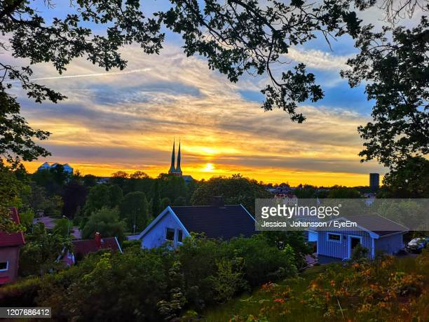 houses and buildings against sky during sunset - vaxjo stock pictures, royalty-free photos & images
