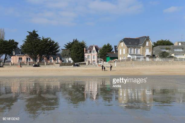 Houses and buildings along the waterfront 'plage de Toulhars' beach in LarmorPlage The beach at low tide