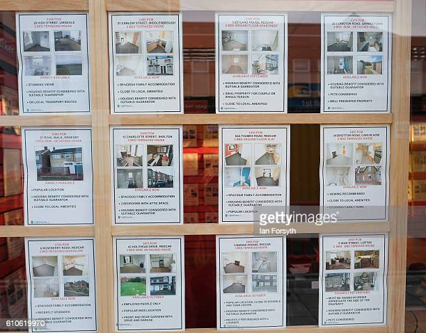 Houses and flats for rent are advertised in an estate agents window on September 27 2016 in Redcar United Kingdom One year on since the SSI steel...