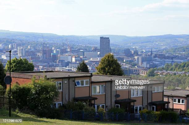 Houses and flats, or residential apartments, are pictured in Sheffield, northern England on May 14 following an easing of the novel coronavirus...