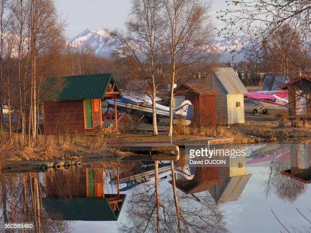 Houses and hydroplanes in Lake Hood banks in Anchorage