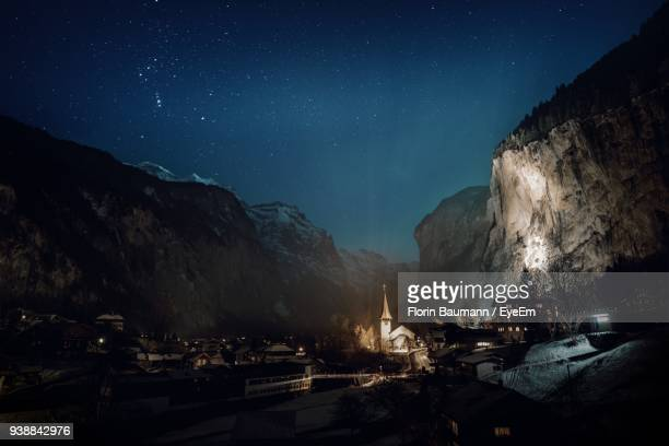 houses and mountains against sky at night - bern canton stock pictures, royalty-free photos & images