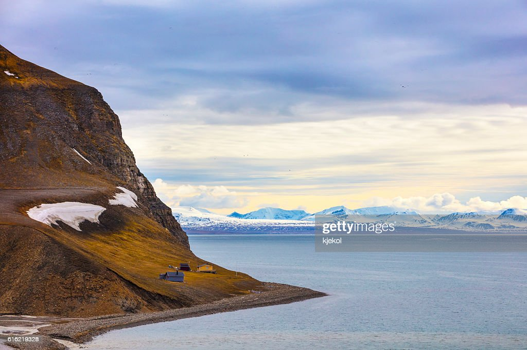 Houses and mountains in arctic summer landscape : Stock Photo