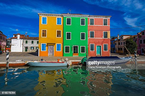 Houses and reflections in canal, Burano, Venice, Italy