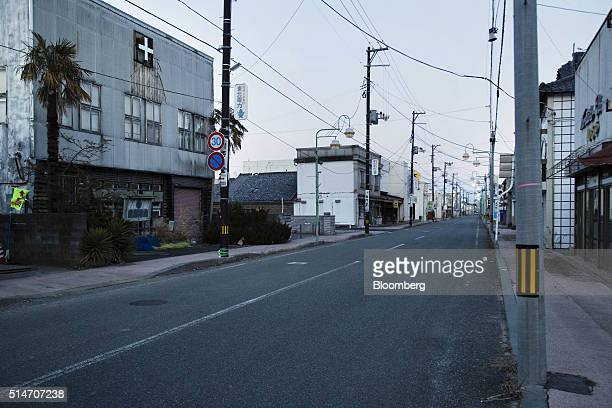 Houses and stores stand along a deserted street in an evacuation zone area damaged by the 2011 earthquake and tsunami in Tomioka Fukushima Prefecture...