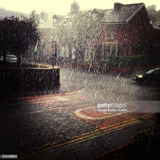 houses and street during rainy season - rain stock pictures, royalty-free photos & images