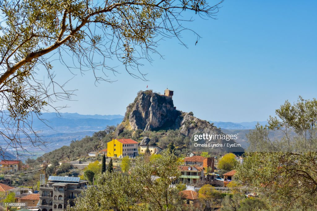 Houses And Trees Against Clear Sky : Stock Photo