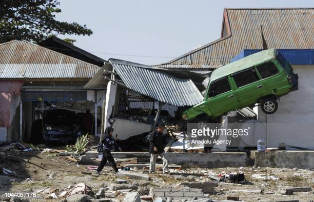 Houses and vehicles damaged by earthquake and tsunami are seen on Talise beach area Palu Central Sulawesi in Indonesia on October 1 2018 The death...