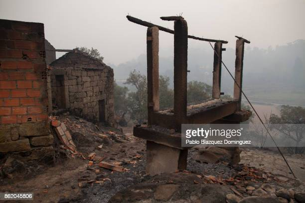 Houses are burnt in the village of Vila Nova near Vouzela on October 16 2017 in Viseu region Portugal At least 30 people have died in fires in...