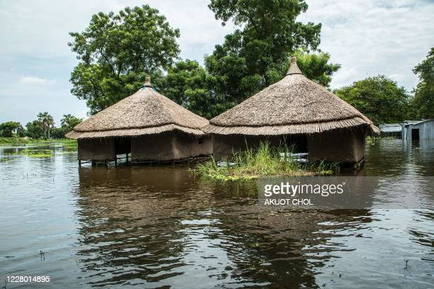 Houses are in flooded area after the Nile river overflowed after continuous heavy rain which caused thousands of people to be displaced in Bor,...