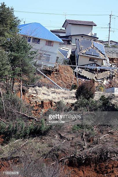 Houses are left damaged by landslides after an 89 magnitude strong earthquake struck on March 11 off the coast of northeastern Japan on March 12 2011...