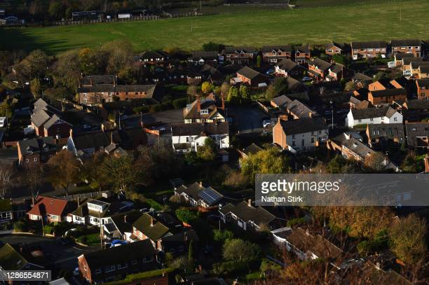 Houses are seen next to Frodsham Wind Farm from Helsby Hill on November 19, 2020 in Helsby, England. The UK Government released details of its ten...