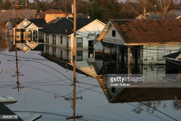Houses are seen submerged under water September 9, 2005 in New Orleans, Louisiana. Thousands of residents of the Gulf Coast are still without...