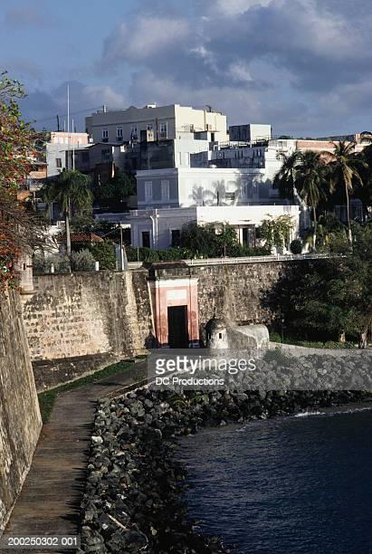 houses at old san juan wall, puerto rico - old san juan wall stock photos and pictures