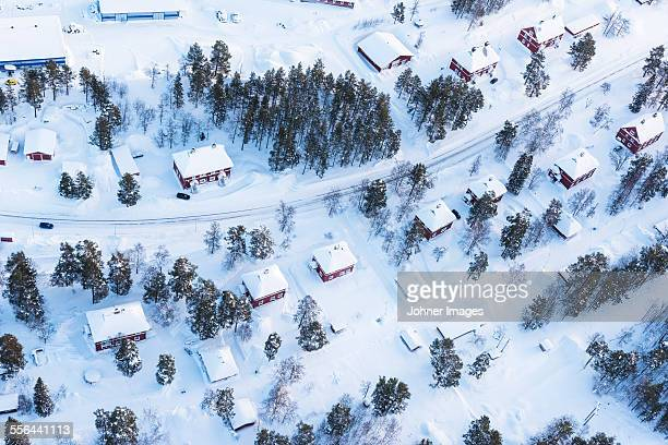 houses at winter, aerial view - swedish lapland stock photos and pictures