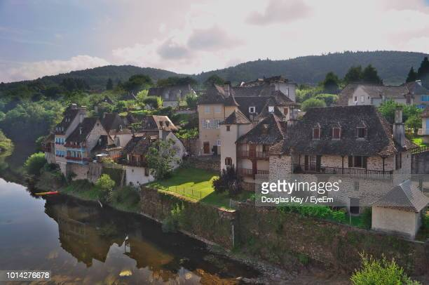 houses by buildings against sky - correze stock pictures, royalty-free photos & images