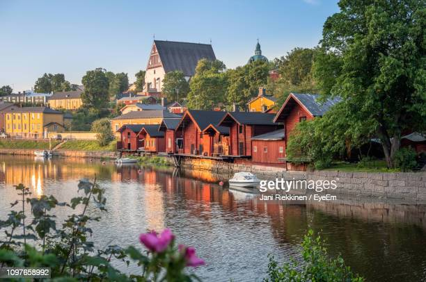 houses by lake and buildings against sky - finland stock pictures, royalty-free photos & images