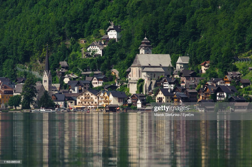 Houses By Lake And Buildings In Town : Stock Photo