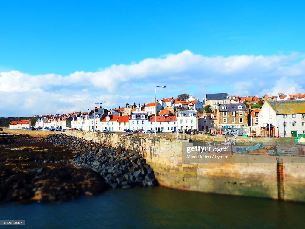 Houses By Pittenweem Harbor Against Sky : Stock Photo