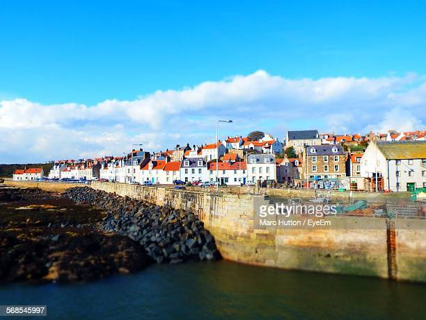 houses by pittenweem harbor against sky - st. andrews scotland stock pictures, royalty-free photos & images