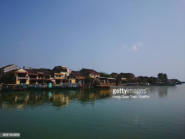 houses by river against blue sky - hong quan stock pictures, royalty-free photos & images