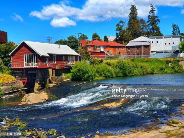 houses by river against buildings - mcgregor stock pictures, royalty-free photos & images