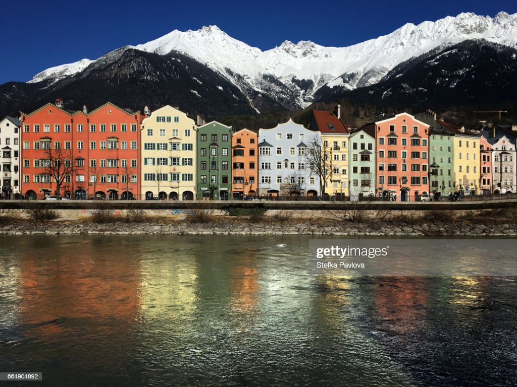 Houses By River And Mountains Against Sky in Innsbruck, Bank of Inn river : Stock Photo