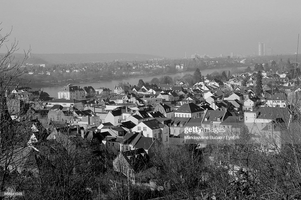 Houses By River In Town Against Sky : Stock Photo