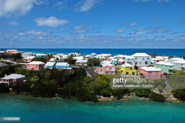 houses by sea against blue sky - bermuda stock pictures, royalty-free photos & images