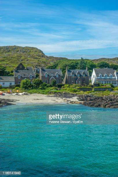 houses by sea against sky - barra scotland stock pictures, royalty-free photos & images