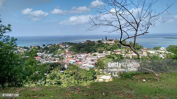 houses by sea against sky - trinidad and tobago stock pictures, royalty-free photos & images