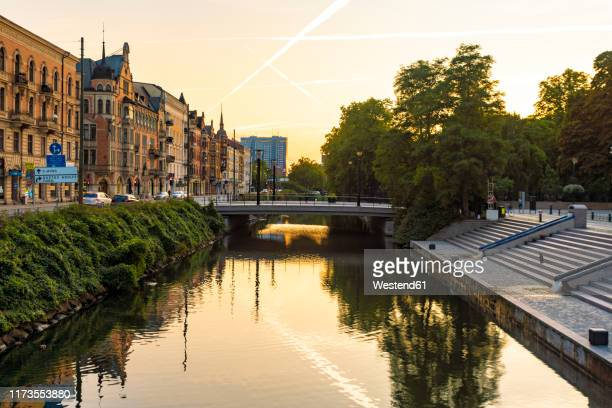 houses by sodra forstadskanalen in city during sunset - malmo stock pictures, royalty-free photos & images