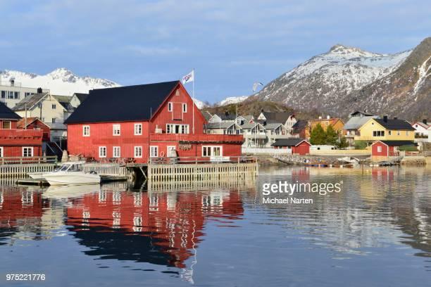 Houses by the harbor, mountains behind, Svolvaer, Austvagoey island, Lofoten, Nordland, Norway